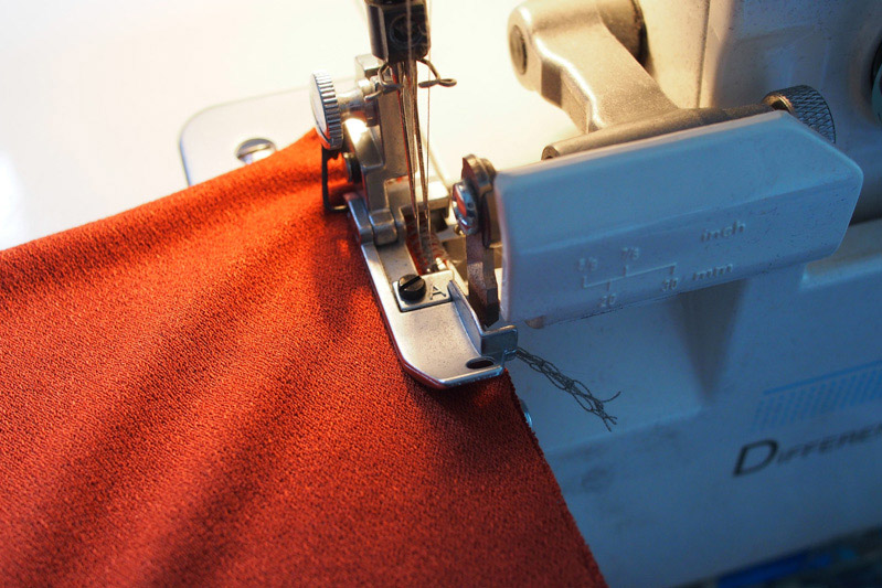 Weave in serger tails as you sew